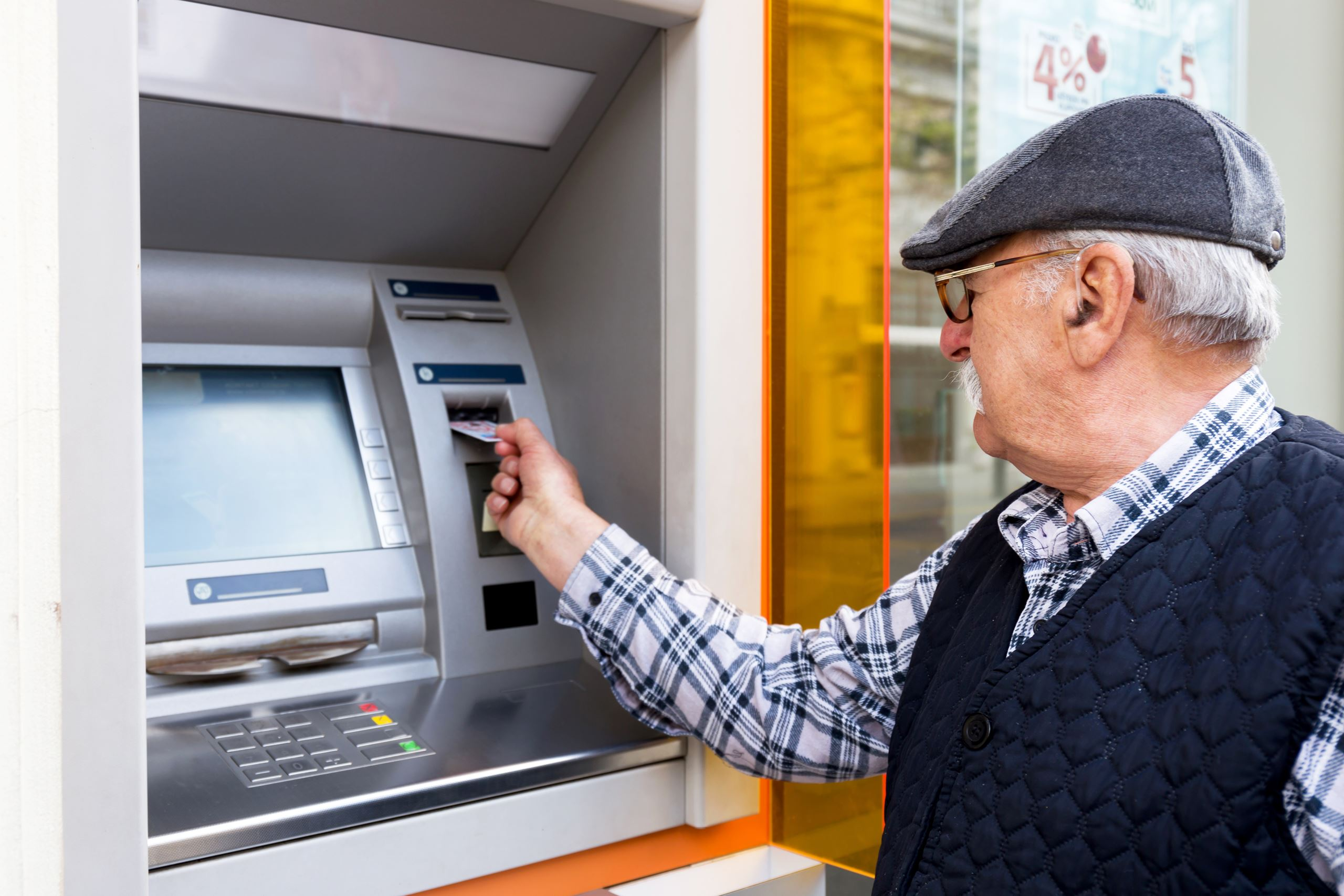 Man standing at ATM